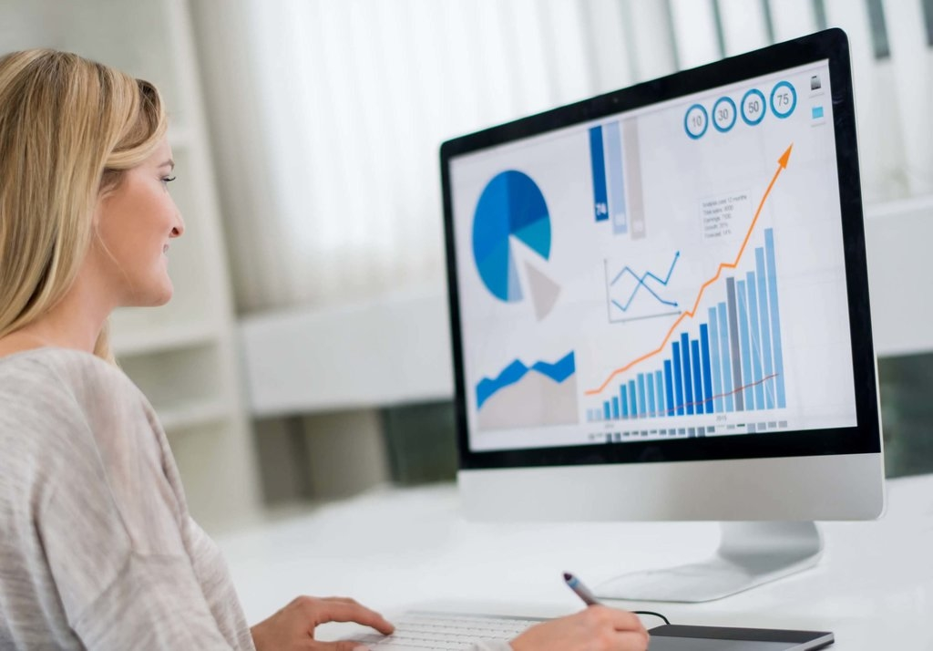 Woman Looking at analytics and Reports