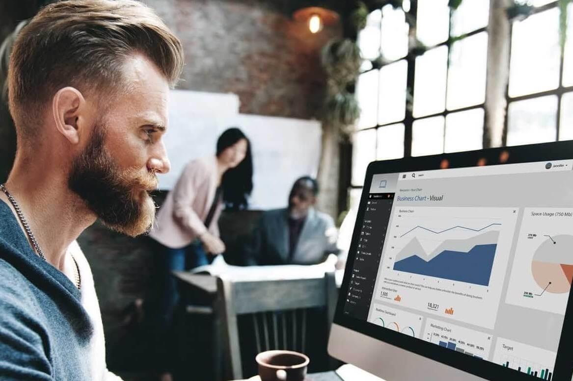 Man looking at sales reports