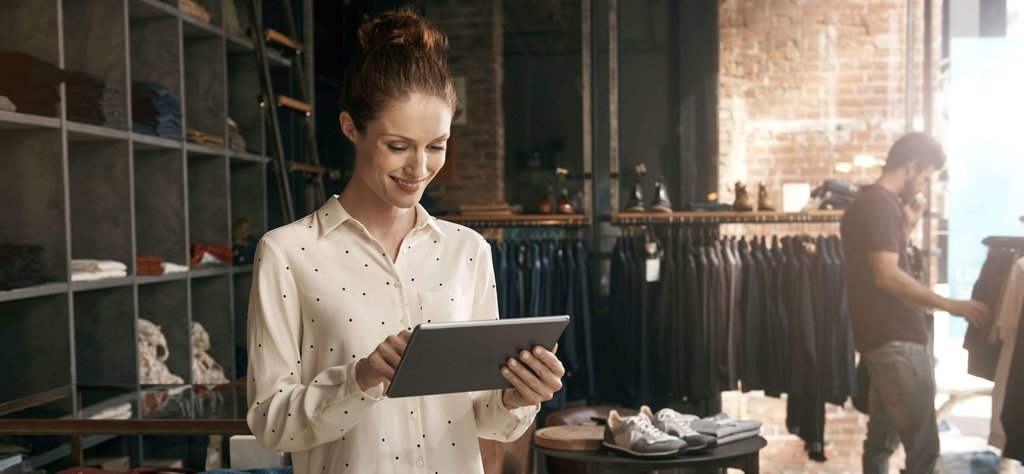 Store staff holding tablet