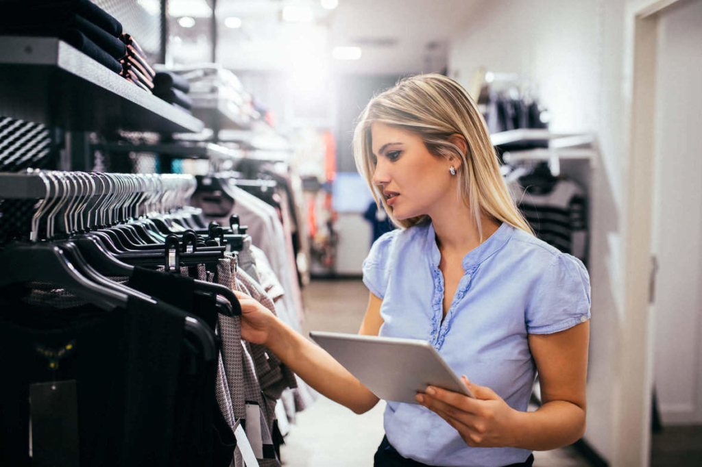 Retail Employee Checking apparel stock